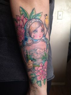 Russian nesting doll tattoo with flowers