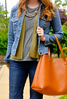 Give your cardigan a casual-cool look by layering it with a denim jacket and statement necklace.