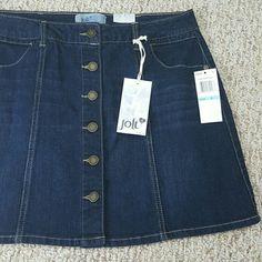 Button Front Denim Skirt Button up dark wash denim skirt with front pockets. Size 5 Jolt Skirts Mini