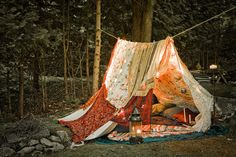 bohemian tent = funky blankets + colorful pillows + rope between trees