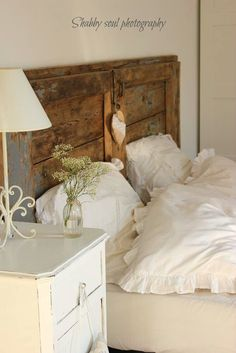 Old door for headboard. Love this and gotta do this.