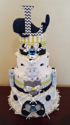 Whale nautical theme diaper cake! Baby shower centerpiece gift.  I love the navy whale! Check out my Facebook page Simply Showers for more pics and orders. Whale Diaper Cake, Nautical Diaper Cakes, Diy Diaper Cake, Baby Boy Cakes, Boy Baby Shower Themes, Baby Boy Shower, Baby Shower Gifts, Baby Shower Cakes, Diy Diapers
