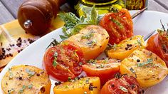 Grilled Tomatoes with Basil Vinaigrette - 47 Ways with Fresh Tomatoes - Southern Living - Fire up the grill for these colorful kabobs featuring red and yellow tomatoes. After grilling, drizzle Basil Vinaigrette over the tomato halves just before serving for added flavor. This side dish pairs well alongside grilled chicken or fish. Recipe: Grilled Tomatoes with Basil Vinaigrette