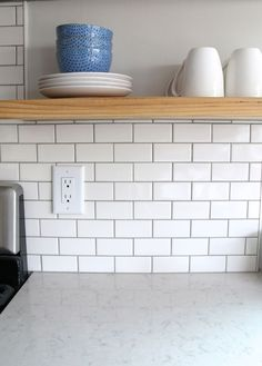 """For the backsplash I went classic with a simple 2″ x 4″ subway tile. I used American Olean White Mosaic Subway Wall tiles with """"Pewter"""" grout also available through Lowe's here.:"""