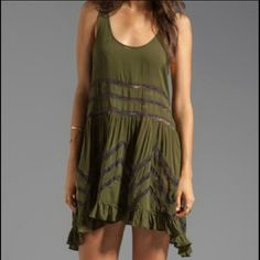 Free People Army Green Voile & Lace *Read Desc.* Free People Voile & Lace Trapeze Slip Can be worn as a Tunic or a Dress on a shorter gal Army Green color EUC Only worn & washed 1 time  Not sure if I'm ready to sell this yet...but I would be willing to trade for 1 of my ISO  *Hence, the price!* NOT actually asking $88 but feel free to use the offer button Free People Dresses Mini
