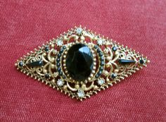 Vintage Florenza black and clear rhinestone open scroll work Victorian revival