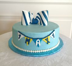 Bow tie themed first birthday - buttercream iced cake with fondant bow