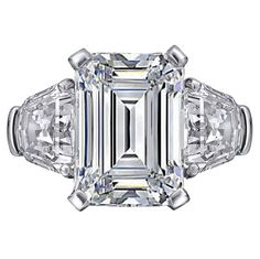 Fancy - Engagement Ring - Large Emerald cut Diamond Engagement Ring with Shield cut side Diamonds