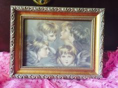 A personal favorite from my Etsy shop https://www.etsy.com/listing/244337228/antique-angel-frame-angel-frame-golden