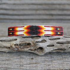 Navajo artist, Judy Wilson hand beaded this fabulous bracelet. Great feather and geometric patterns . The bracelet is backed with a soft leather. Native American Jewellery, Native American Artists, Native American Beadwork, American Jewelry, Loom Beading, Navajo, Nativity, Beaded Jewelry, Cuff Bracelets
