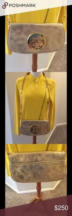 Beautiful authentic Tory Burch Golden Gorgeous gold hardware Tory Burch  11.5 x 6.5 x 1.75 Brushed gold metallic look Symbol signature on front some scratch  Clean inside and outside With dust bag Get noticed everywhere you go with thiS beauty Strap removable for clutch Tory Burch Bags Shoulder Bags