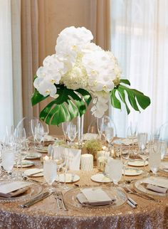 Gold Sequin Linen with Tropical Centerpiece Photography: Jose Villa…