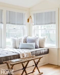 A cozy window seat bathed with natural light is a favorite spot in this Cape Cod home. The breezy shades can be rolled up and fastened with rope, while shutters offer flexible privacy control at the room's front window. Interior architecture and design: Beach Cottage Style, Beach Cottage Decor, Chic Beach House, Home Buying Process, Boho Home, New England Homes, House And Home Magazine, Architecture Design, House Design