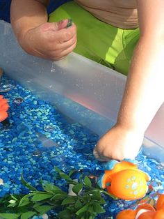 "Sea sensory box. of course!  Oh, how I wish I wasn't terrified of a ""water"" bucket in my living room...they would love this.  When I get brave."
