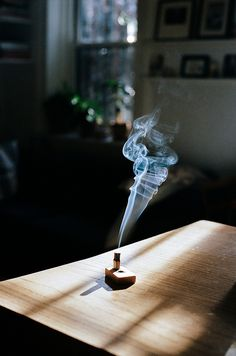 I always wanted to take a picture of smoke like this; I used to watch it billow so elegantly while burning incense but never could take a clear enough picture.