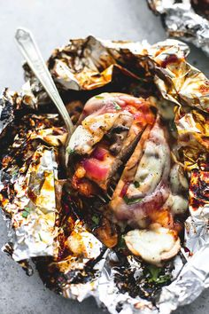 Barbecue chicken topped with onions, mushrooms, and melty cheese. Easy grilled smothered bbq chicken foil packs are the epitome of laidback summertime eats!