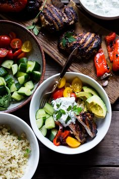 A simple tasty recipe for Grilled Greek Souvlaki Bowl with Cauliflower Rice, flavorful Cucumber Yogurt Sauce and fresh summer vegetables. This can be made with Grilled Chicken or Grilled Portobellos!   www.feastingathome.com