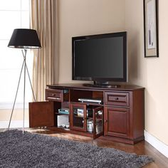 Crosley 60 in. Corner TV Stand - The Crosley 60 in. Corner TV Stand is designed to fit snugly in the corner of your living room, bedroom, or den to make the most out of the sp. Wood Corner Tv Stand, Corner Unit, Corner Tv Wall Mount, Corner Space, Small Corner, Black Entertainment Centers, Entertainment Wall, Corner Tv Cabinets, Raised Panel Doors