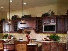 Ideas For Decorating Above Kitchen Cabinets Lovetoknow Your . Kitchen Decoration ideas for decorating above kitchen cabinets Top Of Cabinet Decor, Kitchen Cabinet Interior, Home Decor Kitchen, Kitchen Ideas, Cabinet Ideas, Kitchen Cupboards, Decorating Above Kitchen Cabinets, Above Cabinets, Grey Cabinets