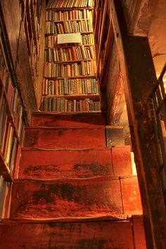 """Shakespeare & Co. Bookshop, Paris ~ """"Set in the heart of Paris on the Left Bank opposite Notre-Dame, Shakespeare and Company has grown from a bookstore into an institution."""" *What an amazing view of these worn steps and old books! Shakespeare And Company, Dream Library, Magical Library, Future Library, Home Libraries, World Of Books, Stairway To Heaven, Paris Photos, Old Books"""