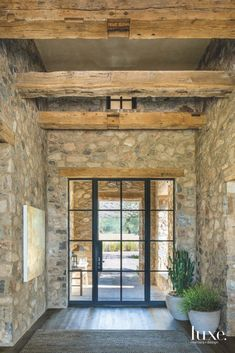 A Design Team Configures A Rustic Retreat In Scottsdale A Design Team Configures A Rustic Arizona Retreat - Luxe Interiors + Design Dressing Room Design, Stylish Bedroom, Stone Houses, Stone Cottages, Hallway Decorating, Mediterranean Style, Rustic Interiors, Interior And Exterior, House Ideas