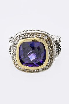 Elizabeth Ring        Live a little bit luxouriously with our Elizabeth ring. A great purple tone jewel in the center of this ring really catches the eye. Whether dressed to the nines or lounging around at home in your velour hoodie and pants, isn't it about time you spoiled yourself a little bit?!      $37.99  http://janashadugavaches.wix.com/janashadugavaches