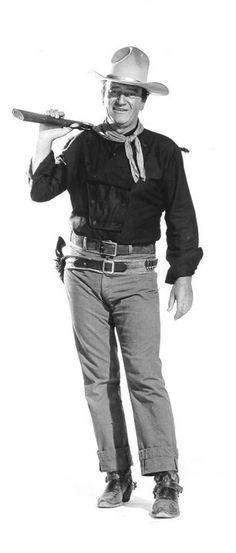 THE MAN WHO SHOT LIBERTY VALANCE (1962) - John Wayne as 'Tom Donophan' - Directed by John Ford - Paramount - Publicity still.