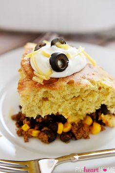 Mexican Beef and Cornbread Bake ~ taco-seasoned beef, black beans, and corn are topped with green chile cheddar cornbread in this quick, easy meal | FiveHeartHome.com