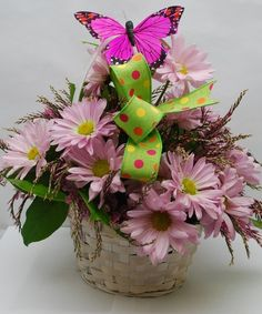 Butterfly Basket-A dainty whitewashed wicker basket overflowing with lavender daisies and chorus magenta, accented with a fluttering butterfly and a decorative bow. New Baby Flowers, Beach Flowers, Flowers Today, Easter Flowers, Colorful Flowers, Beautiful Flowers, Send Flowers, Get Well Flowers, Decorative Bows