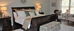 Olmsted Master Suite - love the black sleigh bed and grey walls