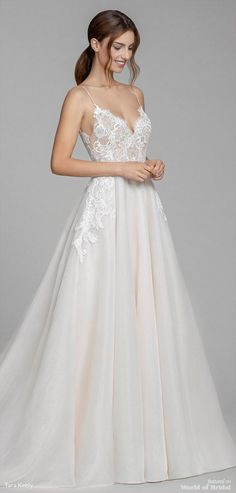Ivory and cashmere organza A-line bridal gown, ballerina scalloped neckline front and back, Alencon lace bodice with nude underlay, circular skirt, chapel train.