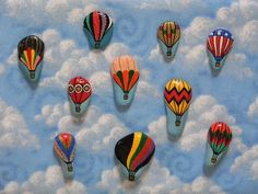 hot air balloons painted on rocks