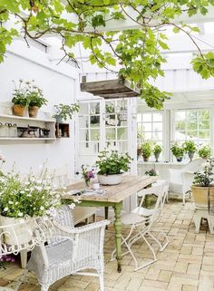 Rustic furniture complements an antique brick floor perfectly in this bright and airy garden room. Outdoor Rooms, Outdoor Gardens, Outdoor Living, Outdoor Furniture Sets, Outdoor Decor, Rustic Furniture, Antique Furniture, Conservatory Ideas Interior Decor, White Wicker Patio Furniture