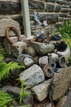Collected geodes..cool way to display collected rocks in the garden