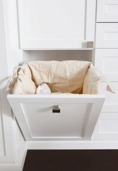 Laundry hamper that folds back into your closet. Love it! via California Closets Toronto