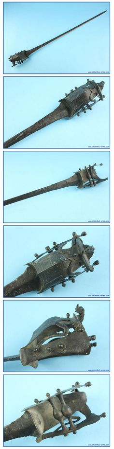 Indian hooded katar, 18th century, a very old long version of the katar. A development stage between the pata (long gauntlet sword) and the short katar push dagger. Very long and narrow38in blade. The cross bars are shaped like small balls. The handle is protected with a steel hood terminating in a styled yali (monster head) shaped tip. 44 inches total length.. http://www.oriental-arms.co.il/