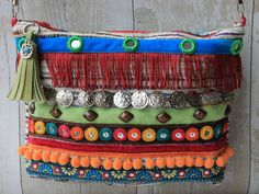This clutch bag has been hand made using reclaimed textiles. The exterior is a vintage woven fabric with an slubby striped design with metallic silver threads running throughout. This fabric has some loose fine threads and raised section which is all part of the fabrics charm. The front of