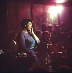 30 Powerful Pictures That Defined American History  Jazz singer Ella Fitzgerald performs at Chicago's Mr. Kelly's nightclub in 1958.