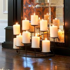 This metal candelabra features ten platforms to hold candles and a sturdy base. The candelabra is constructed of two rows, five platforms on each of the front and back rows. Harper Blvd furniture brin