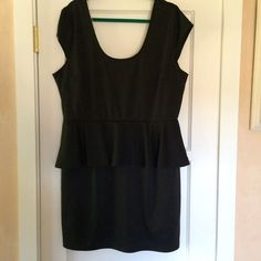 Peplum dress Pretty black peplum dress. It has short cap sleeves. Classic peplum shape at the waist. Very stretchy. 96% polyester and 4% spandex. Great for holiday parties! Delirious Dresses
