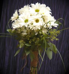 Bouquets of daisies for the bridesmaids by Emil J Nagengast Florist, Albany, NY.