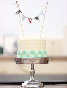 Looks like an easy DIY - homemade cake with fondant circles for decor.