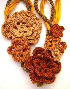 Autumn Colors Irish Crochet Necklace - a 28 inch crocheted cord necklace of linen in autumn colors with linen and cotton irish Crochet Roses in 3 shades of copper/rust. The entire necklace is wrapped in a deep yellow Sari Silk (Fair Trade, recycled). MEMBER - Topaz08