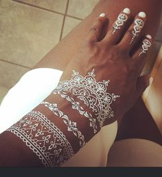Our latest addition are the amazing white henna tattoos. Apply with just water and viola, you have a cool henna creation. Henna Tattoos, White Henna Tattoo, Skin Color Tattoos, Body Art Tattoos, Tattoo Skin, Temporary Tattoos, Ankle Tattoos, Word Tattoos, White Tattoo Dark Skin