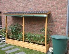 Ein Tomatenhaus ans Haus angelehnt Holz, Garten, Tomaten, Gemüseanbau