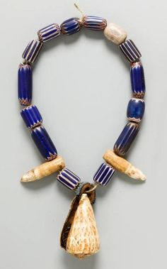 Africa - Necklace from Cameroon.Glass trade beads, shell, teeth and fiber