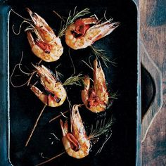 Rosemary-Skewered Shrimp recipe from Food & Wine ~ These simple skewers are lovely because of their distinct rosemary flavor, which completely infuses the charred shrimp and sweet red peppers. They can be made on a grill or in a grill pan on a stovetop. Seafood Appetizers, Seafood Recipes, Wine Recipes, Seafood Dishes, Pasta Recipes, Shrimp Skewers, Shrimp Tacos, Shrimp Boat, Best Grilled Shrimp Recipe