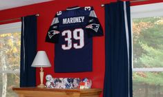 How to hang a jersey on the wall! BIG Colorado Avalanche fan. Have official jerseys to hang up.