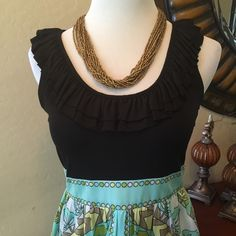 Cute Ruffle Top Dress NWOT The top of the dress has a cute ruffle and the bottom half is lined with a cute floral design. The necklace pictured is not included. Thanks so much for looking!!!  London Style Dresses