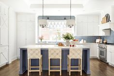 Tile backsplashes that go all the way up to the ceiling make us 🥰 Design by @briahammelinteriors. Photo by @spacecrafting_photography.  Tile featured: @annieselke Artisanal Smokey Blue Subway. Kitchen Interior, Kitchen Design, Kitchen Ideas, Kitchen Updates, Blue Tile Backsplash Kitchen, Kitchen Cabinets, Blue Kitchen Island, The Tile Shop, Wall And Floor Tiles